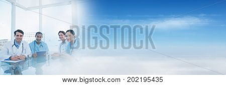 Digital composite of Medical doctors and people having a meeting with blue sky transition effect