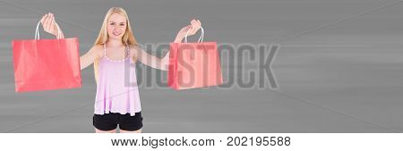 Digital composite of Shopper with red bags against blurry grey background