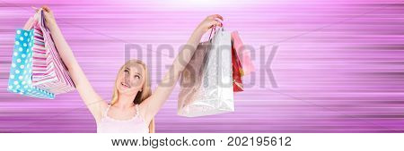 Digital composite of Shopper with bags in air against blurry purple background
