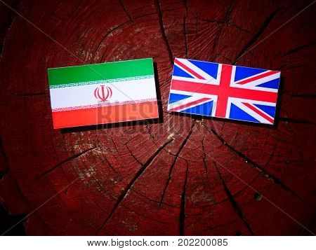 Iranian Flag With British Flag On A Tree Stump Isolated