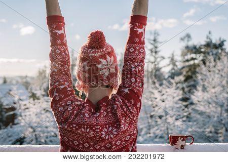 Carefree woman enjoy winter morning.