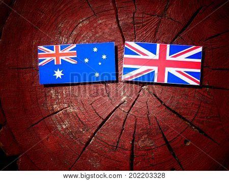 Australian Flag With British Flag On A Tree Stump Isolated
