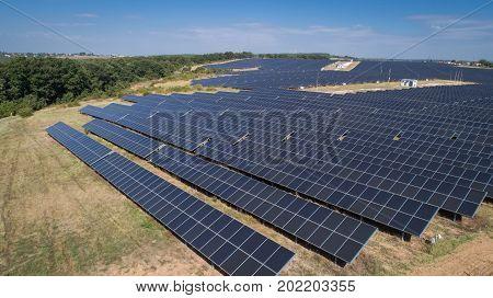 Aerial shot of photovoltaics solar farm. Solar farm power station from above. Ecological renewable energy.