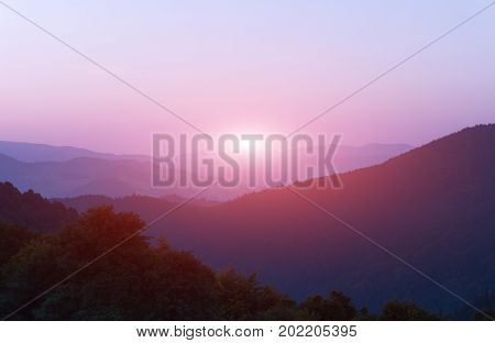 Summer Dawn in mountains. Sunrise in mountains
