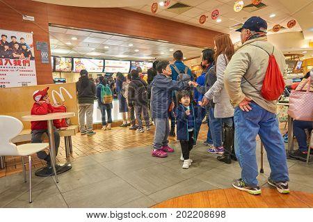 HONG KONG - JANUARY 27, 2016: people queue at a McDonalds's in Hong Kong. McDonald's is an American hamburger and fast food restaurant chain.