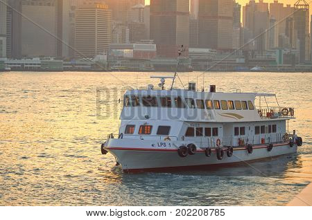 HONG KONG - JANUARY 25, 2016: a vessel in Victoria Harbour. Victoria Harbour is a natural landform harbour situated between Hong Kong Island and Kowloon in Hong Kong.