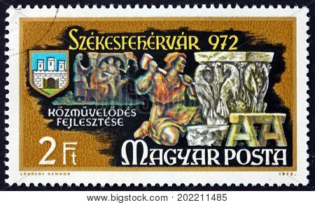 HUNGARY - CIRCA 1972: a stamp printed in Hungary shows Sculptor at Work Education Millennium of the Town Szekesfehervar circa 1972
