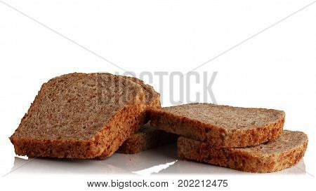 cut into pieces a loaf of bread from sprouted grains on a white background