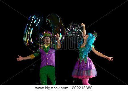 Artist team make amusement soap bubble. Soap bubble show in black studio.