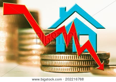 The percent symbol аnd real estate and on the background of bars coins . The concept of mortgage lending