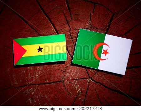 Sao Tome And Principe Flag With Algerian Flag On A Tree Stump Isolated