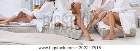 Group of woman in robes Womens legs in the spa unquestionable crop