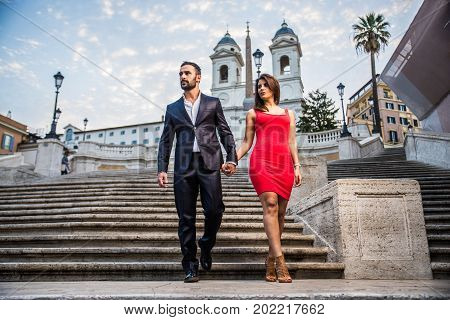 Beautiful couple dating in Rome Italy - Boyfriend and girlfriend walking outdoors at Spagna Square and Trinita' dei Monti
