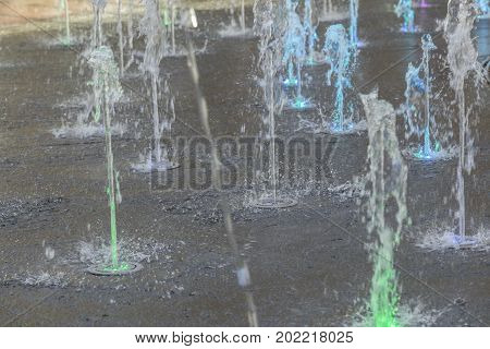 Water fountain on concrete floor for background