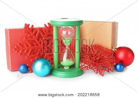 Hourglass and decorations on white background.Christmas countdown concept