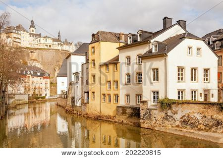 Alzette river running through Grund and Ville Haute above, Luxembourg city
