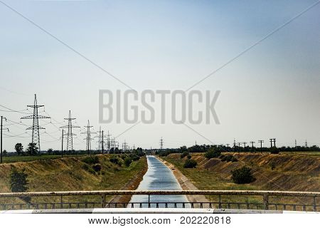 The Irrigation Channel Of Water Supply And High-voltage Power Lines