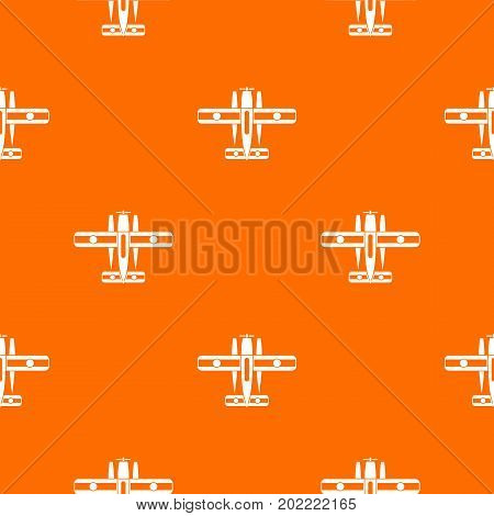 Ski equipped airplane pattern repeat seamless in orange color for any design. Vector geometric illustration