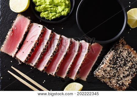 Sesame Seed Crusted Seared Tuna Served With Wasabi And Sauce Closeup. Top View Horizontal