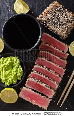 Sesame Seed Crusted Seared Tuna Served With Wasabi And Sauce Closeup. Top View Vertical
