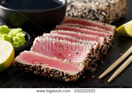 Seared Ahi Tuna With Sesame Seeds And Soy Sauce, Wasabi, Lime Macro. Horizontal