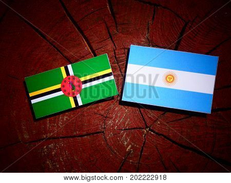 Dominica Flag With Argentinian Flag On A Tree Stump Isolated