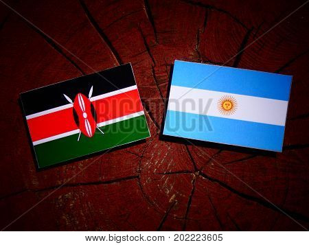 Kenyan Flag With Argentinian Flag On A Tree Stump Isolated