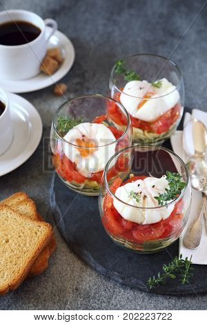 Three verrines breakfast. Poached eggs tomatoes and zucchini and caps of coffee. Citron thyme garnish
