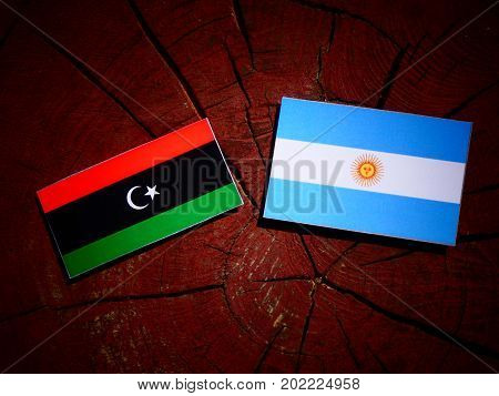 Libyan Flag With Argentinian Flag On A Tree Stump Isolated
