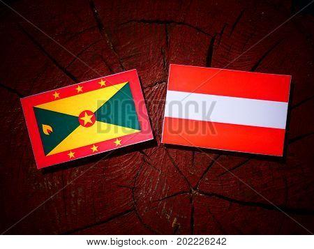 Grenada Flag With Austrian Flag On A Tree Stump Isolated