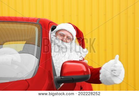 Authentic Santa Claus in car showing thumb up gesture