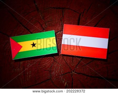 Sao Tome And Principe Flag With Austrian Flag On A Tree Stump Isolated