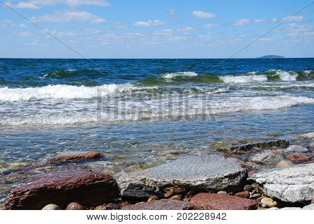 Colorful coastline with flat rocks at the swedish island Oland in the Baltic Sea