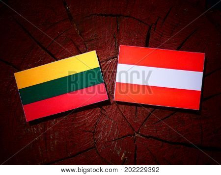 Lithuanian Flag With Austrian Flag On A Tree Stump Isolated