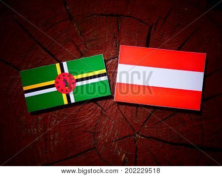Dominica Flag With Austrian Flag On A Tree Stump Isolated