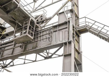 Last row steel column and crane beam with deadlock stop. Brake disconnecting rail on the overhead crane. Fragment of the metal frame industrial plant shop.