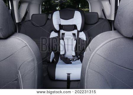 Child safety seat in car salon