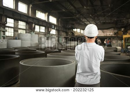 Worker in workshop of concrete batching plant