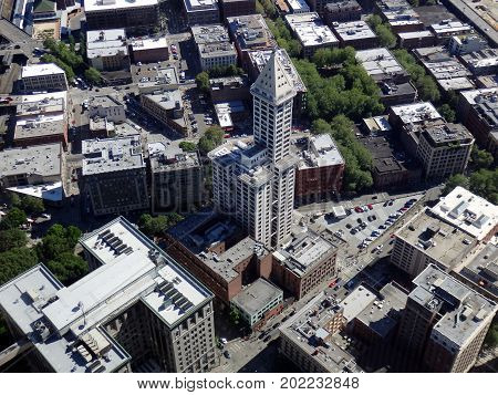 SEATTLE-- JUNE 25: Big beautiful view of Smith Tower building 38-story 149 m tall building was completed in 1914 and surrounding Seattle downtown from a high vantage point on June 25 2016 in Seattle WA.