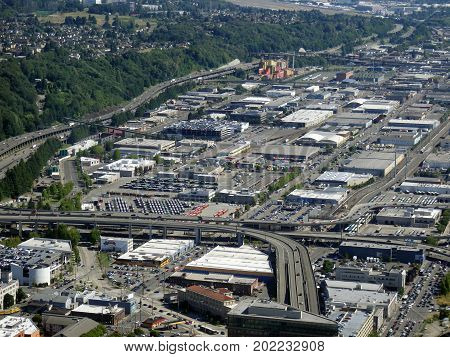 SEATTLE-- JUNE 25: Aerial view of downtown Seattle buildings warehouses forest and Highway on June 25 2016 in Seattle WA.