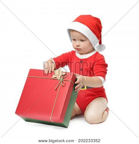 Cute little baby with giftbox on white background. Christmas concept