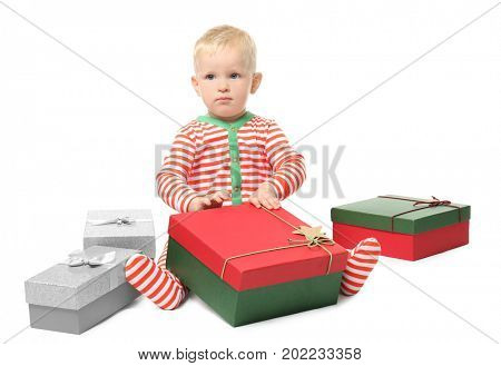 Cute little baby with giftboxes on white background. Christmas concept