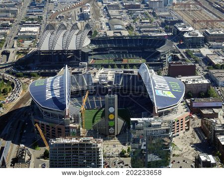 SEATTLE - JUNE 25: Aerial view of CenturyLink train tracks buildings roads and Safeco Field in Seattle in June 25 2016. Home of the Seattle Seahawks (NFL) Mariners (MLB) and Sounders (MLS).