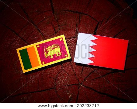 Sri Lankan Flag With Bahraini Flag On A Tree Stump Isolated