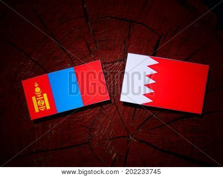 Mongolian Flag With Bahraini Flag On A Tree Stump Isolated