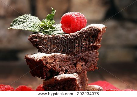 Homemade Chocolate Brownies With Raspberries And Mint On Wooden Background