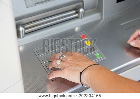 Young Woman Arms At The Cash Machine