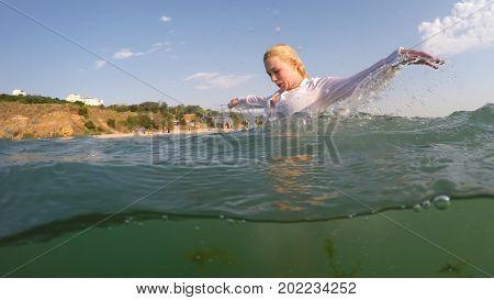 businesswoman have ? fun on a sea beach
