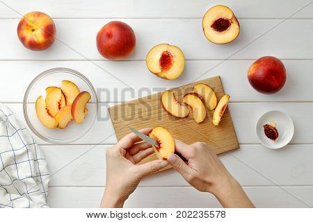 Step By Step Recipe Galette Or Pie With Nectarines. Female Hands Cut Nectarines Into Slices For Cake