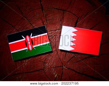 Kenyan Flag With Bahraini Flag On A Tree Stump Isolated